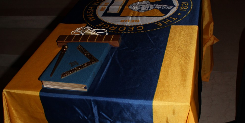 The GWU flag adorns the preparation table, with jewels, working tools, and more